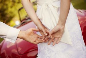 wedding-car-with-bride-and-groom