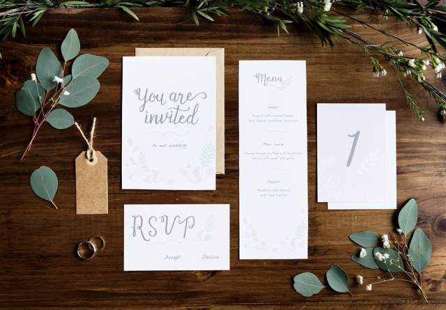 wedding-invitation-cards-papers-laying-on-table