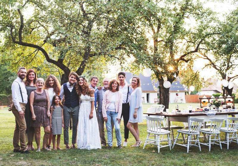 bride-groom-guests-posing-for-the-photo