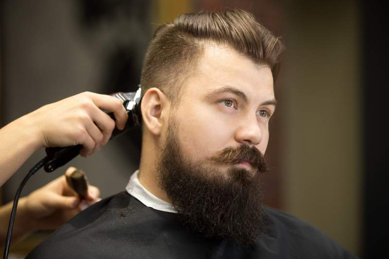 young-bearded-man-hairdresser-salon
