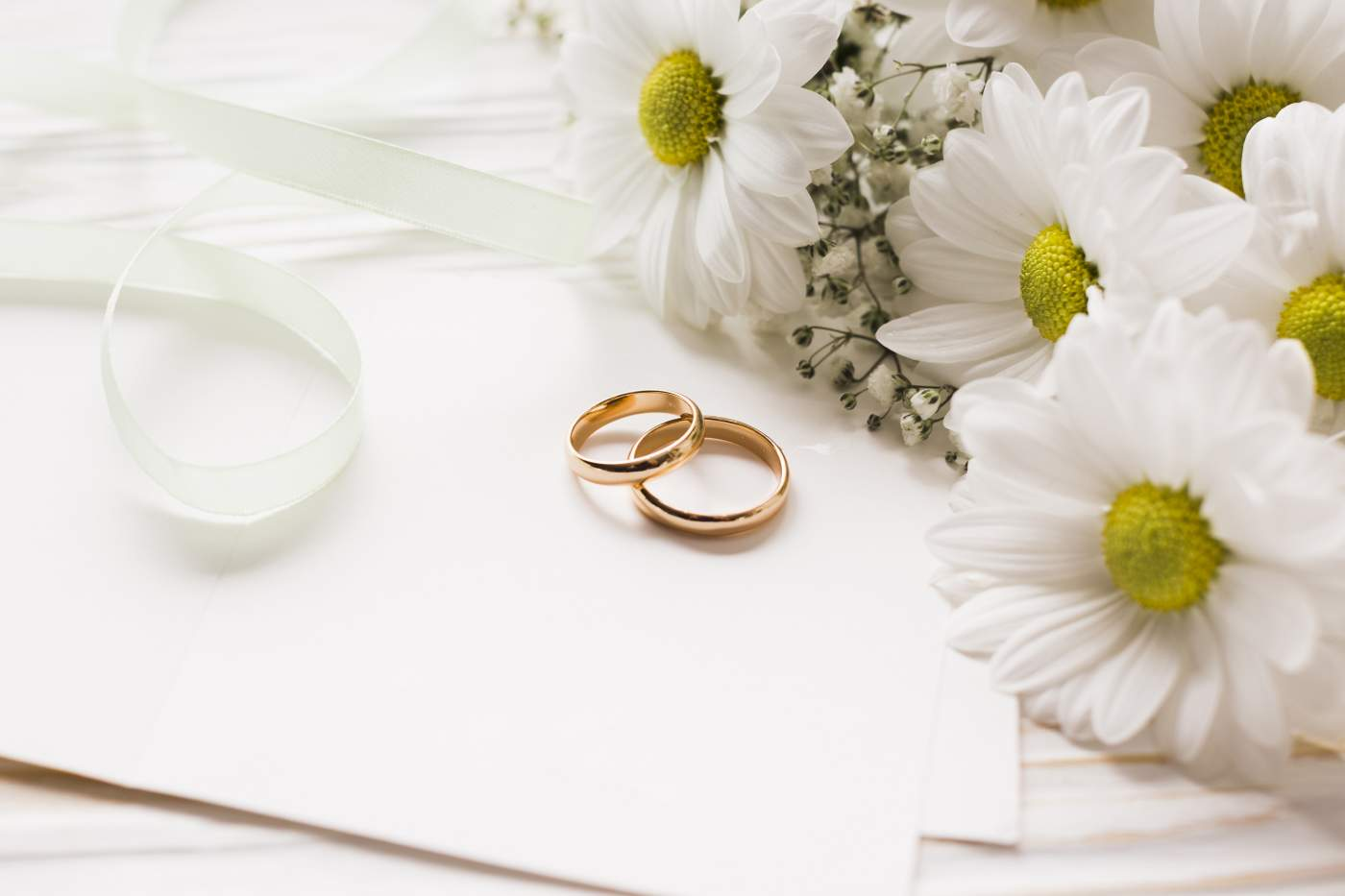 Blooming flowers with engagement rings